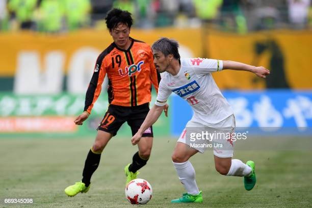 Takayuki Funayama of JEF United Chiba controls the ball under pressure of Yuji Hoshi of Renofa Yamaguchi during the JLeague J2 match between Renofa...