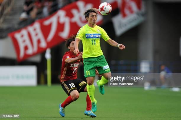 Takayuki Funayama of JEF United Chiba controls the ball under pressure of Koji Noda of Zweigen Kanazawa during the JLeague J2 match between JEF...