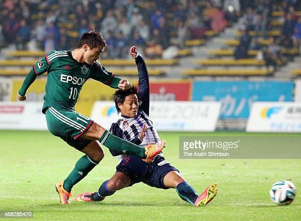 Takayuki Funayama of Matsumoto Yamaga scores his team's first goal during the JLeague second division match between Avispa Fukuoka and Matsumoto...