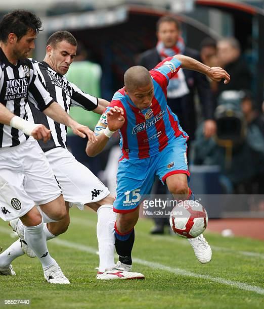 Takayuki Morimoto of Catania Calcio battles for the ball with Alexandros Tziolis of AC Siena during the Serie A match between Catania Calcio and AC...