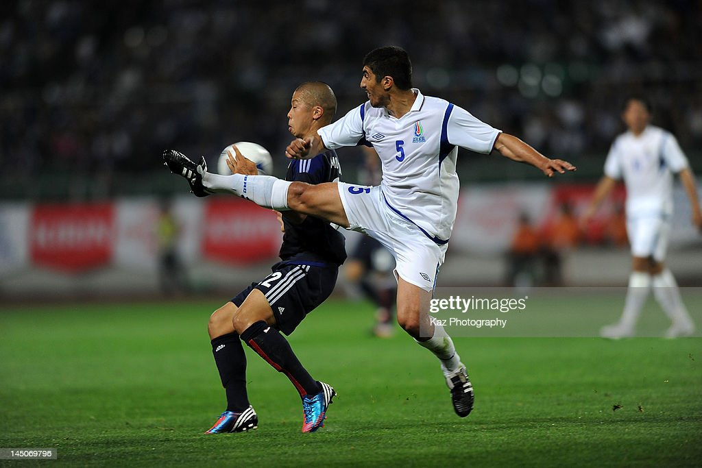 Takayuki Morimoto (L) of Japan in action during the international friendly match between Japan and Azerbaijan at Ecopa Stadium on May 23, 2012 in Kakegawa, Japan.