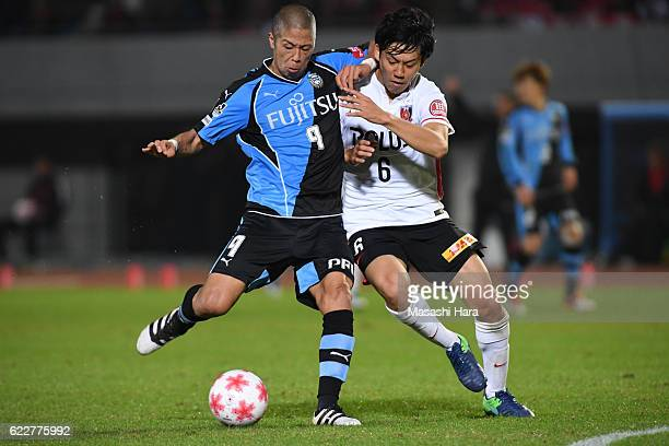 Takayuki Morimoto of Kawasaki Frontale and Wataru Endo of Urawa Red Diamonds compete for the ball during the 96th Emperor's Cup fourth round match...