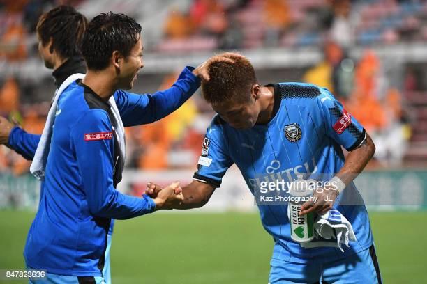 Takayuki Morimoto of Kawasaki Frontale is congratulated by Yu Kobayashi after their 30 victory in the JLeague J1 match between Shimizu SPulse and...