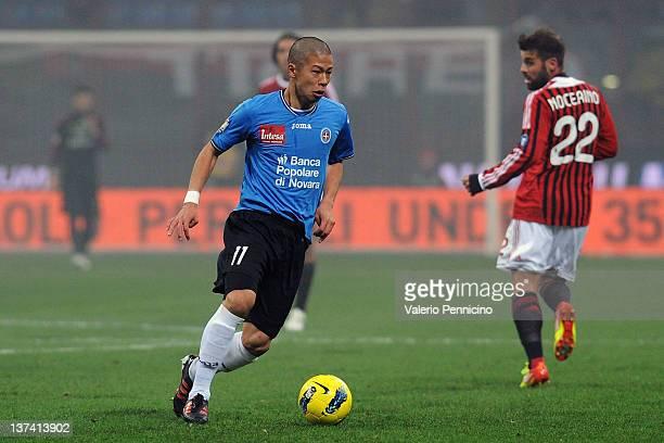 Takayuki Morimoto of Novara Calcio in action during the TIM Cup match between AC Milan and Novara Calcio at Giuseppe Meazza Stadium on January 18...