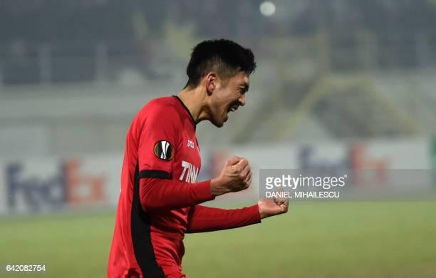 Takayuki Seto of Astra Giurgiu celebrates after he scored 22 during the UEFA Europa League round of 32 firstleg football match between FC Astra and...