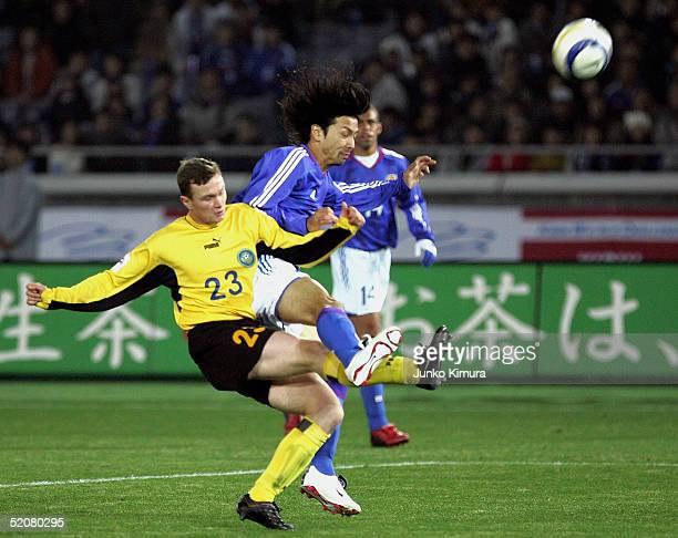 Takayuki Suzuki of Japan and Igor Soloshenko of Kazakhstan in action during the Kirin Challenge Cup 2005 between Japan and Kazakhstan on January 29,...