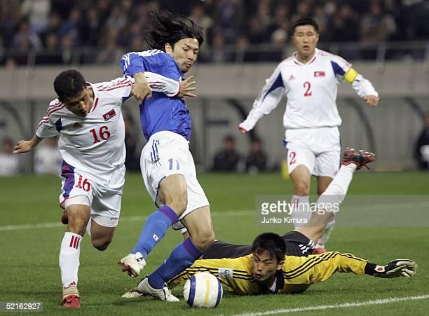 Takayuki Suzuki of Japan and Nam Song Chol in actionduring the 2006 FIFA World Cup Asian qualifying match between Japan and North Korea at Saitama...