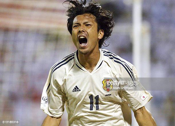 Takayuki Suzuki of Japan celebrates scoring his team's first goal during the FIFA World Cup Asian first qualifier match between Oman and Japan on...