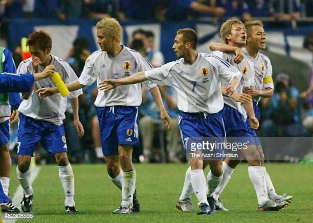 Takayuki Suzuki of Japan celebrates scoring his team's first goal with his teammate Ryuzo Morioka during the FIFA World Cup Korea/Japan Group H match...