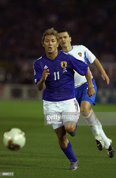 Takayuki Suzuki of Japan charges forward during the FIFA World Cup Finals 2002 Group H match between Japan and Russia played at the International...
