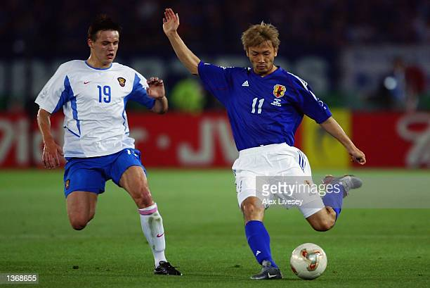 Takayuki Suzuki of Japan lines himself up for a shot at goal during the FIFA World Cup Finals 2002 Group H match between Japan and Russia played at...