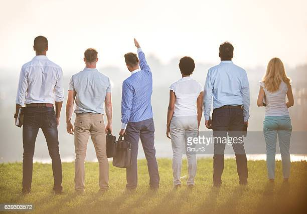 take a look over there colleagues! - smart casual stock pictures, royalty-free photos & images