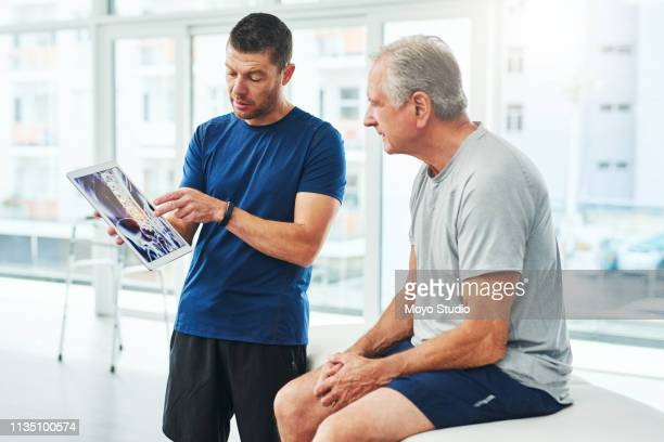 take a look - osteopath stock photos and pictures
