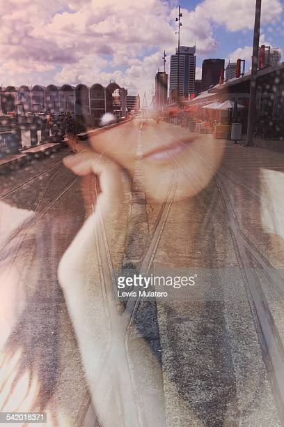 Take a tram to the city for lunch Self portrait double exposure Female face wearing sunglasses and large floppy hat double exposed with tram lines...