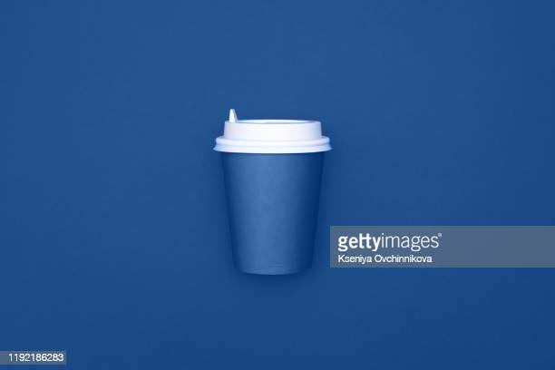 take away coffee cup on colorful paper background - disposable cup stock pictures, royalty-free photos & images