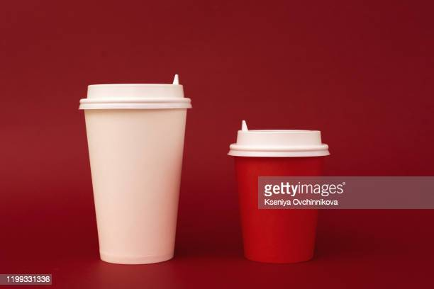 take away coffee cup on colorful paper background - 蓋 ストックフォトと画像