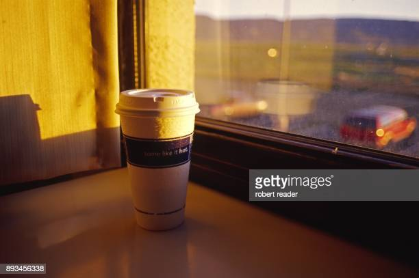 Take away coffee cup sitting on window sill
