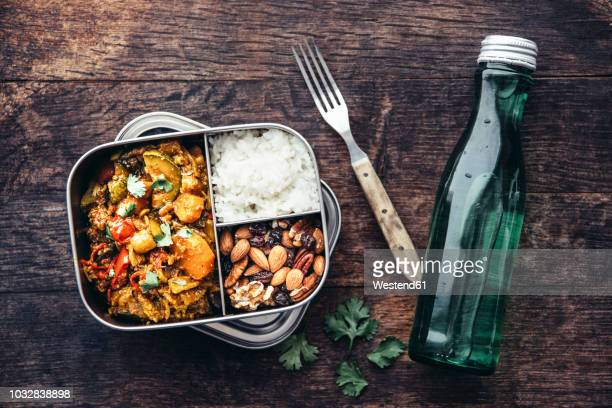 Take Away Food, tamarind vegetable stew, carrot, zucchini, bell pepper, eggplant, onion, tomato and falafel balls, rice and nuts with raisins
