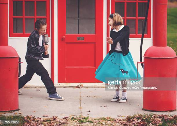 take back the 50's - poodle skirt stock photos and pictures