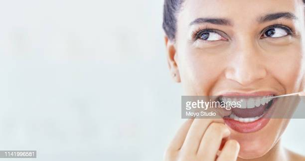 take better care of your teeth - dental floss stock pictures, royalty-free photos & images