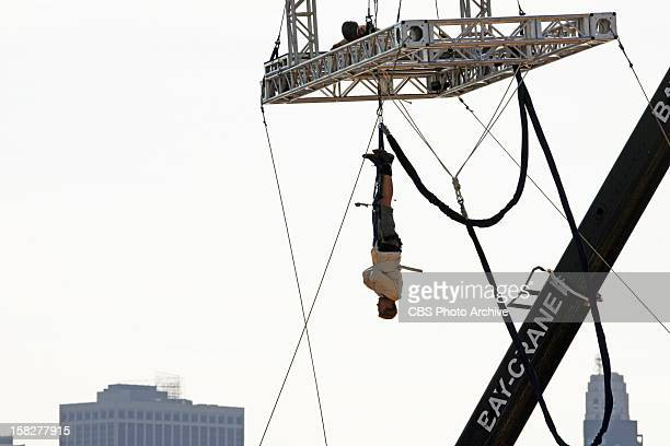 'Take Down that Million'In this Road Block Jaymes must escape from a straightjacket while hanging upside down over the Brooklyn Navy Yard in order to...