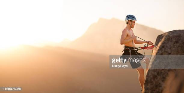 take every precaution while rock climbing - nicky pende foto e immagini stock