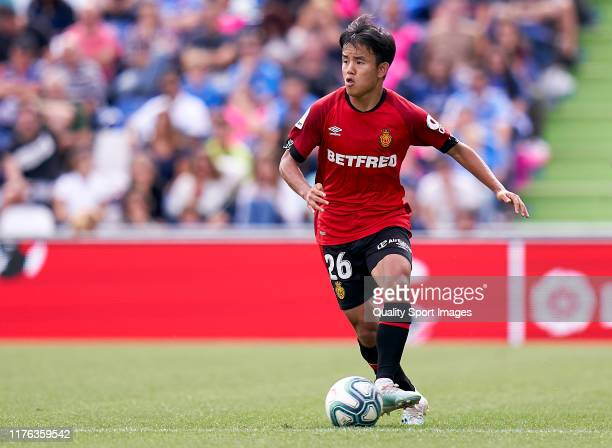 Take Kubo of RCD Mallorca runs with the ball during the La Liga match between Getafe CF and RCD Mallorca at Coliseum Alfonso Perez on September 22...