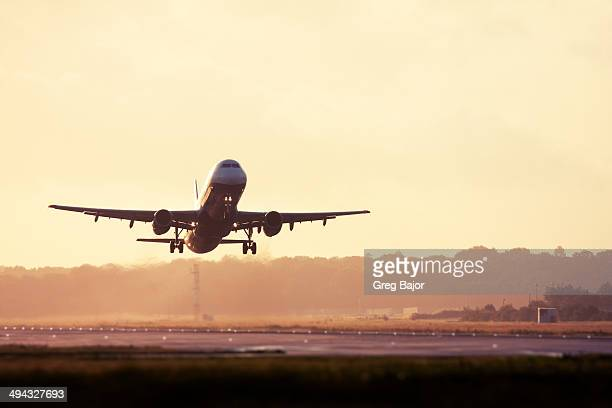 take off - plane stock photos and pictures