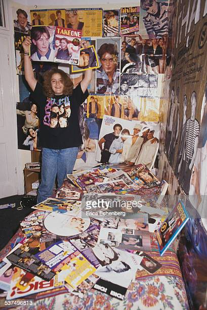 Take That fan in a bedroom, surrounded by posters, London, United Kingdom, January 1993.