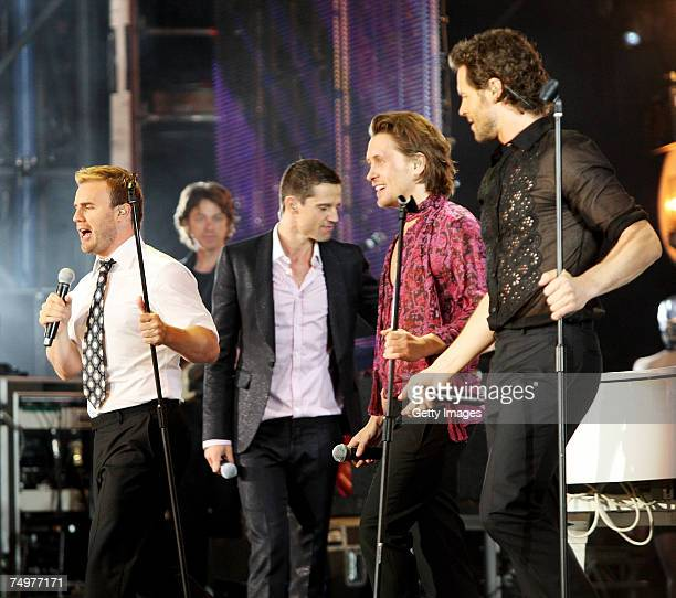 Take That Gary Barlow Jason Orange Mark Owen and Howard Donald perform on stage at the Concert for Diana at Wembley Stadium on July 1 2007 in London...