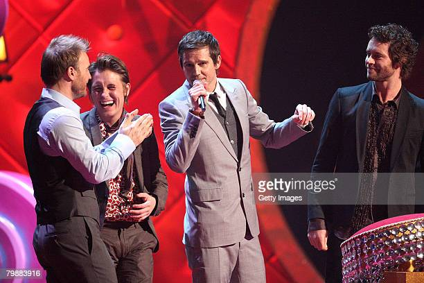 Take That Gary Barlow, Mark Owen, Jason Orange and Howard Donald accept the Live Award on stage at the BRIT Awards 2008 at Earls Court 1 on February...