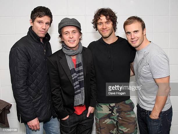 Take That Jason Orange Mark Owen Howard Donald and Gary Barlow pose backstage at Odyssey Arena at the start of their 'Beautiful World Tour' on...