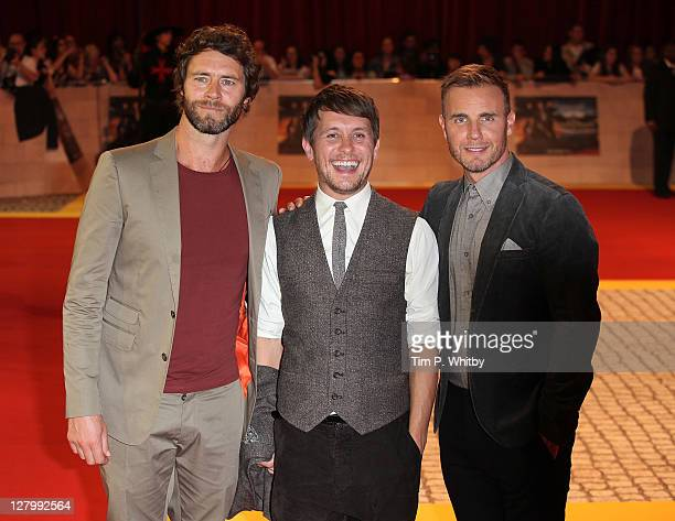 Take That members Howard Donald Mark Owen and Gary Barlow attend the E One presents the world exclusive premiere of 'The Three Musketeers' at Vue...