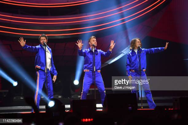 Take That perform on stage at the FlyDSA Arena on April 12, 2019 in Sheffield, England.