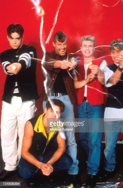 Take That studio group portrait letting off party poppers London LR Robbie Williams Howard Donald Jason Orange Gary Barlow Mark Owen