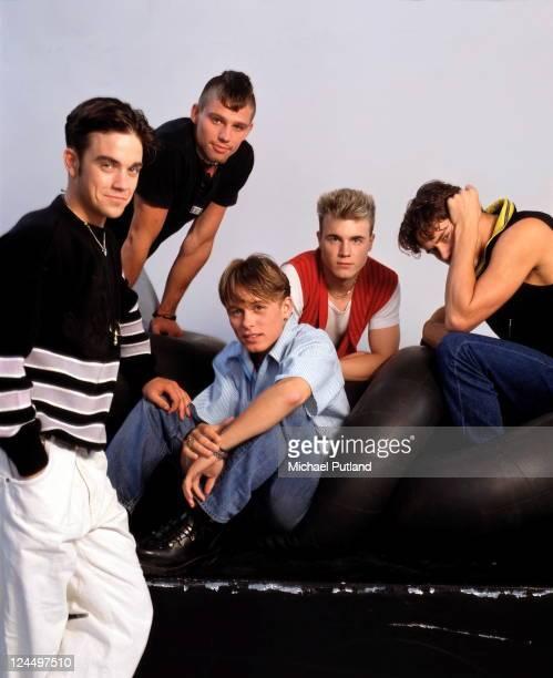 Take That studio group portrait London LR Robbie Williams Jason Orange Mark Owen Gary Barlow Howard Donald