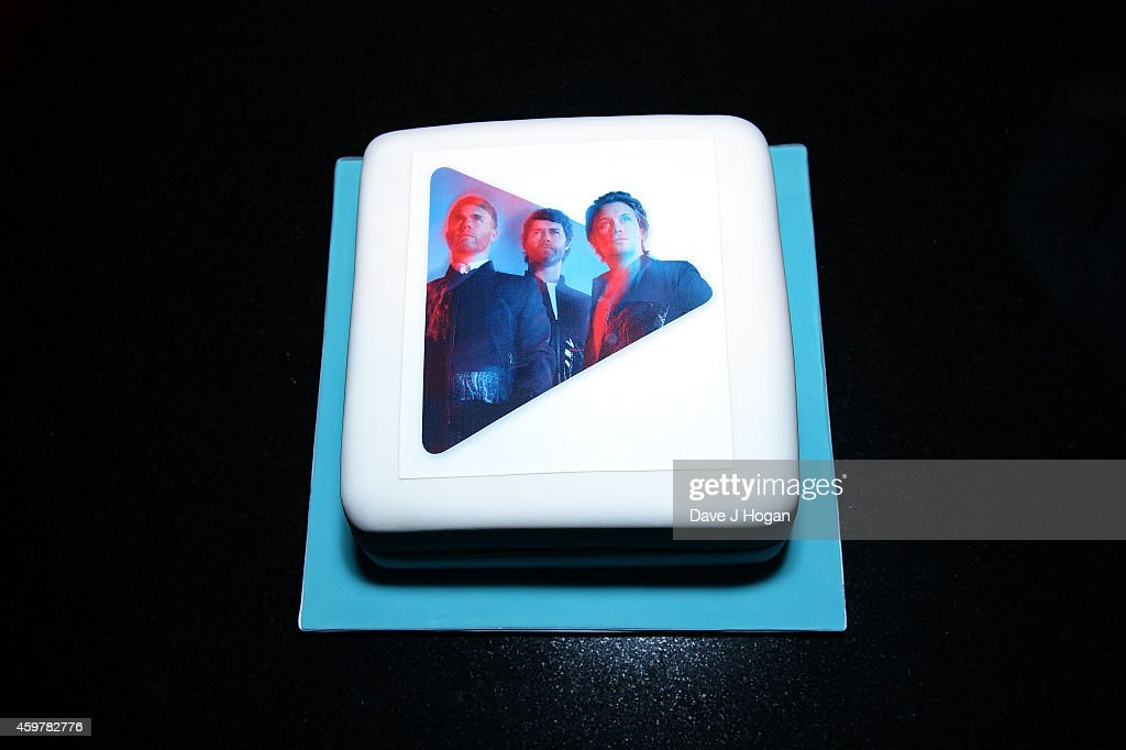 Take That's cake is seen at the Exclusive Google Play gig to launch their new album 'III' which will be available to stream exclusively on Google Play throughout December at Dover St Arts Club on December 1, 2014 in London, England.