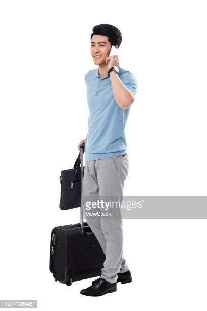 take the luggage business man make a phone call - zakelijke kleding stock pictures, royalty-free photos & images