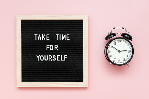 Take time for yourself. Motivational quote on letterboard and black alarm clock on pink background. Top view Flat lay Copy space Concept inspirational quote of the day 1180975850