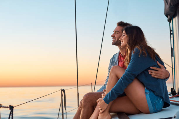 take to the seas for a life of ease - couples romance stock pictures, royalty-free photos & images