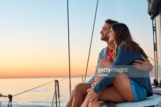 take to the seas for a life of ease - sunset lake stock photos and pictures