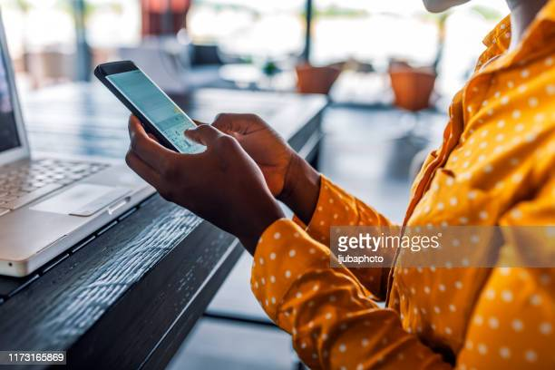 take your business online and watch it grow - black hand holding phone stock pictures, royalty-free photos & images
