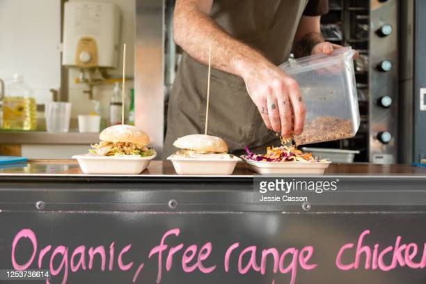 takeaway food being prepared on biodegradable plates in a food truck - food truck stock pictures, royalty-free photos & images