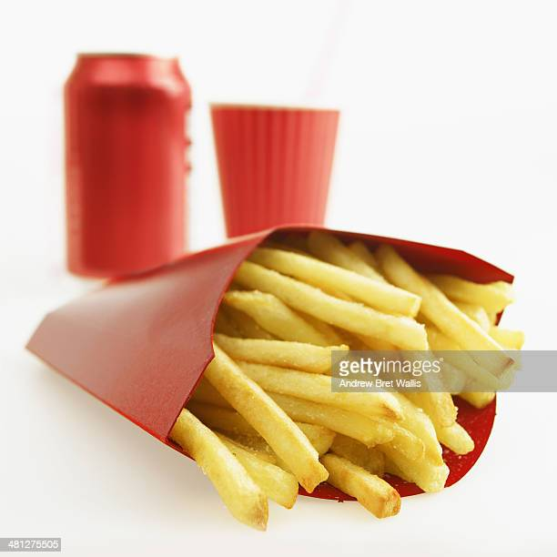 Takeaway fries with soda can and cup