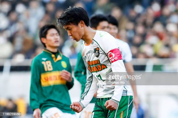 Takeda Hidetoshi of Aomori Yamada celebrates his goal by penalty shots during the 98th All Japan High School Soccer Tournament final match between...