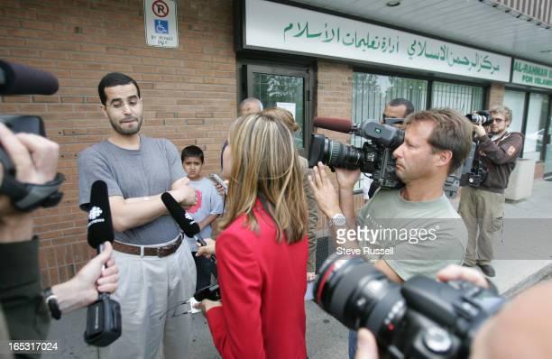 Reporters talk to Sam Lela outside the Al-Rahman Islamic Centre for Islamic Education on Montevideo Road in Mississauga where Qayyum Abdul Jamal...