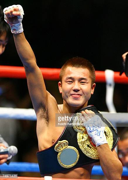 Takefumi Sakata of Japan celebrates after his win against Roberto Vasquez of Panama during the WBA flyweight title bout at Ariake Colosseum on July...