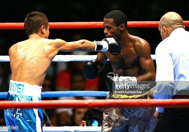 Takefumi Sakata of Japan fights against Roberto Vasquez of Panama during the WBA flyweight title bout at Ariake Colosseum on July 1, 2007 in Tokyo,...