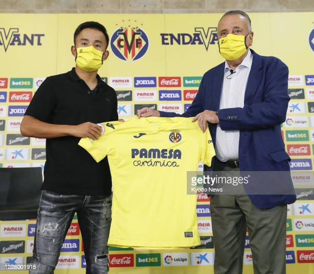 Takefusa Kubo a 19yearold Japanese winger shows his new team's uniform in Villarreal Spain on Aug 11 as he joined Villarreal on a oneyear loan from...