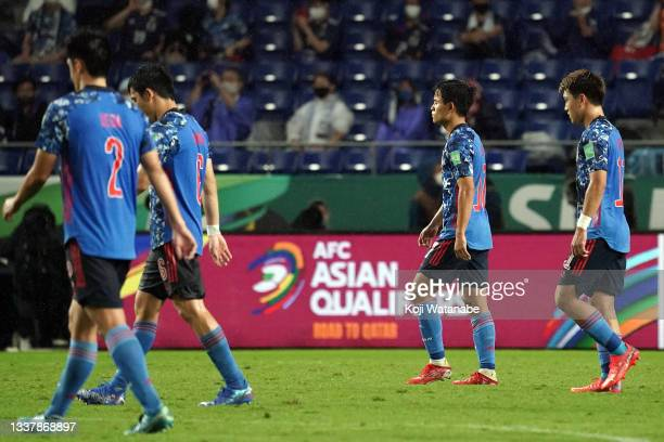 Takefusa Kubo and Ritsu Doan of Japan leave the field after losing the FIFA World Cup Asian Qualifier Final Round Group B match between Japan and...
